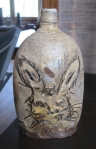 A bottle with a rabbit.
